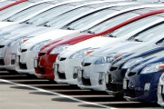 A row of 2010 Toyota Prius hybrid vehicles sit for sale in the car lot at the Toyota dealership in California.